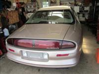 oldsmobile aurura 4 door std sedan 8 cylinder 4.0 liter