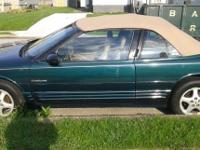 1995 Oldsmobile convertible soft top green in color