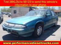 Options Included: Power Door Locks, AM/FM Stereo Radio,