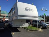 This RV features 1 slide an outdoor awning outdoor