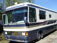 This coach is low mileage at 57,025. It has air ride 4