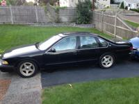 Black 1996 chevy impala, power windows, seats,