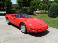 Red/Red leather; white convertible top; 6 speed manual