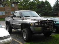 Description 318 V8 auto, Warn Winch, Brush Guard,