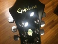 This 1996 Epiphone Dot hollow electric guitar is barely
