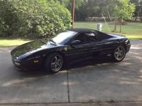 This is a car fax certified 1996 Ferrari F355 spider