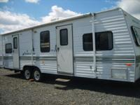 TRAVEL TRAILER: Queen size bed. Living room sofa bed,