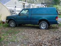 Ford Ranger XLT with matching cap. No rot on body. Has