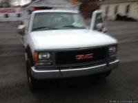 THIS 1996 GMC K3500 4X4 UTILITY TRUCK IN WHITE HAS