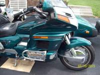 I have my 1996 Honda GoldWing with matching trailer up