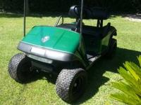 Lifted EZGO cart, not sure how high.  2009 batteries