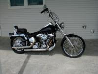 Here's a beautiful Harley Softail with only 22K actual