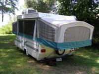 This is a 1996 Jayco Popup camper trailer (model 1006).