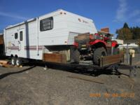 This is a very clean 1996 Jayco Eagle toyhauler, with a