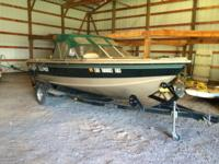 Complete with 150 hp Johnson motor, trailer, depth