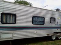 Selling a 1996 Mallard RV 2 bedroom living room and