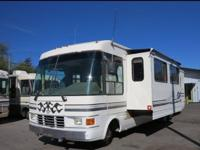 1996 National Dolphin 35' Class A Motorhome. Model is