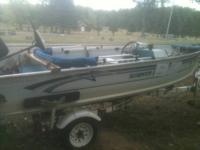 14 ' smokercraft with 28 hp Evinrude with very low