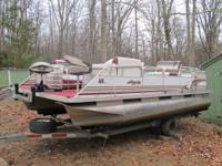 This is a 1997 18' Playbouy Pontoon Boat.  It has a 40