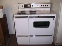 "1997 40"" coiltop range GE self cleaning oven New model"