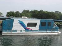 THIS IS A 1997 32' AQUA CHALET HOUSE BOAT. THE BOAT HAS