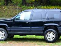 1997 Jeep Grand Cherokee with original 94,080 miles. No