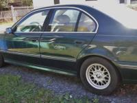 Mileage is 217,378. 1997 BMW, emerald green , auto