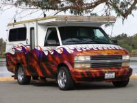 The vehicle is constructed atop a Chevrolet Astro Van