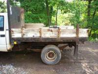 350,auto,69k,2 wheeldrive,1 ton,8 ft flatbed,mechanical