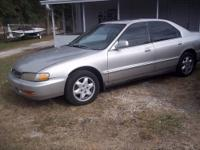 This is a 1997 Honda Accord 4-door, V-6 with automatic