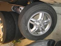 A set of OEM alloy wheels with tires (a few miles left)