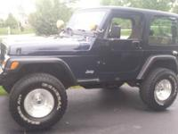 "5 speed manual with 2"" lift kit, 4 wheel drive, this"