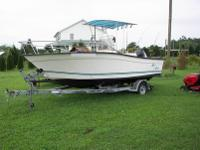 We have a nice 20.1' 1997 Key Largo center console for