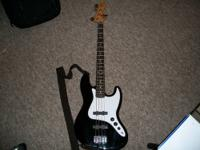 1997 MIM Fender Jazz 4 string bass, black body with