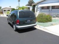 1997 Mini Van, 7 passenger, dark green. Runs good, air
