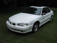 1997 PONTIAC GRAND AM SE. Blue Outside, Gray Inside,