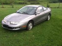 For sale 1997 Saturn 2 door good body trans smokes bad