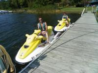 2 seadoo jetskis GTI 1997 on trailer at our home. we