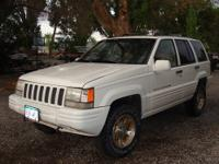 1997 White Jeep Grand Cherokee Limited 4WD, Engine 5.2