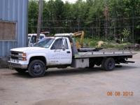 1997 Chevy C3500 Ramp Car Carrier truck. This truck has