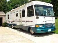 35 foot fiberglass RV, one slide out, Chevy 454 engine,