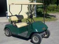 Gas golf cart in good shape. Includes top & club/ball