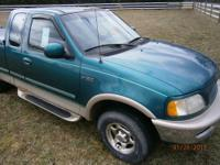 Ford F150, 3 door, green, extended cab, 120,000 miles,