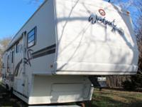 Moving! This wonderful camper MUST go! This 5th wheel