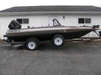 1998 CAJUN FISH AND SKI BASS BOAT AND TRAILER. 17 FT.