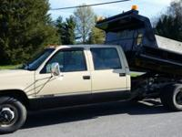 1998 Chevrolet 3500 Crew Cab Dump Truck. Powered by a