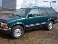 1998 CHEVEY S10 BLAZER 4X4. HUNTER GREEN AND TAN