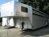 This is a 1998 Custom Fab gooseneck stock trailer. It