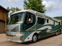 1998 American Eagle Coach by Fleetwood with slide-out.