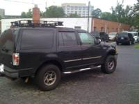 very nice 98 ford expedition sitting on Mickey Thompson